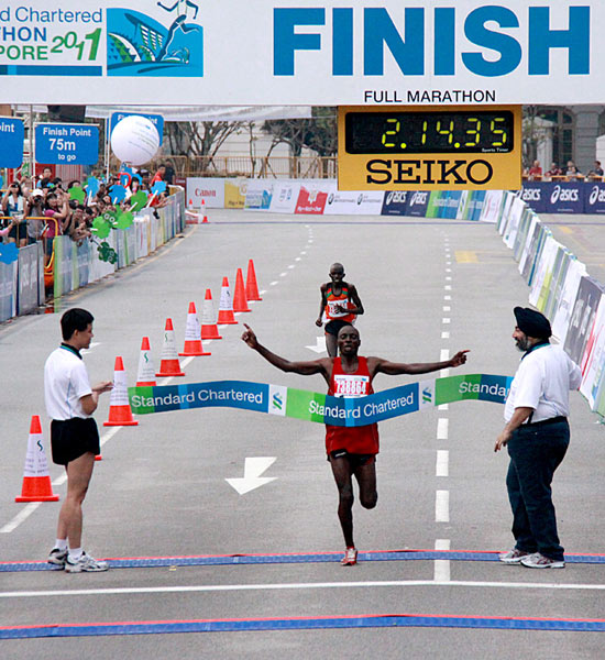 Charles Mwai Kanyao finishes a mere five seconds ahead of his rival
