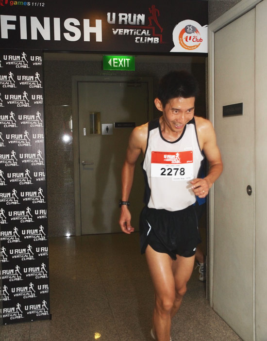 Ang Chee Yong, Winner, 10KM + Vertical Climb Men's Open category - at the finish line NTUC Centre roof