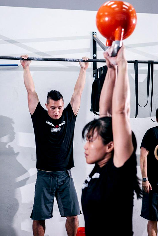 CrossFit athletes putting up a demonstration