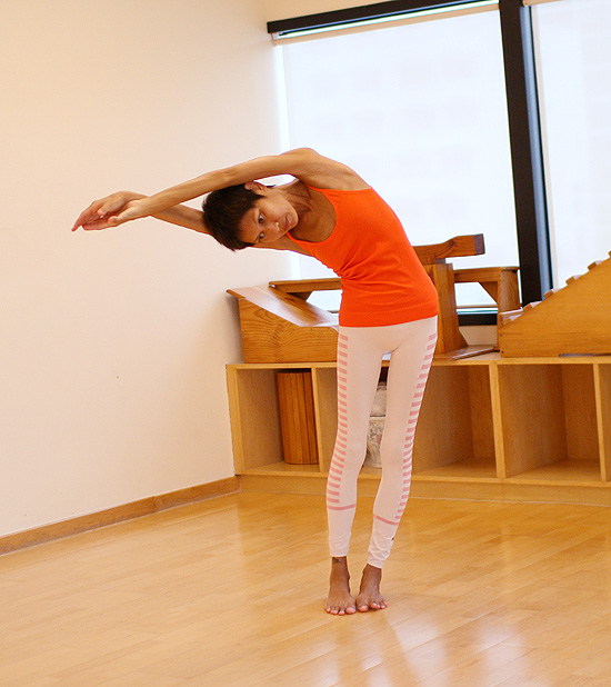 Pose #1: Side stretch- for the waist, IT band, kidneys.