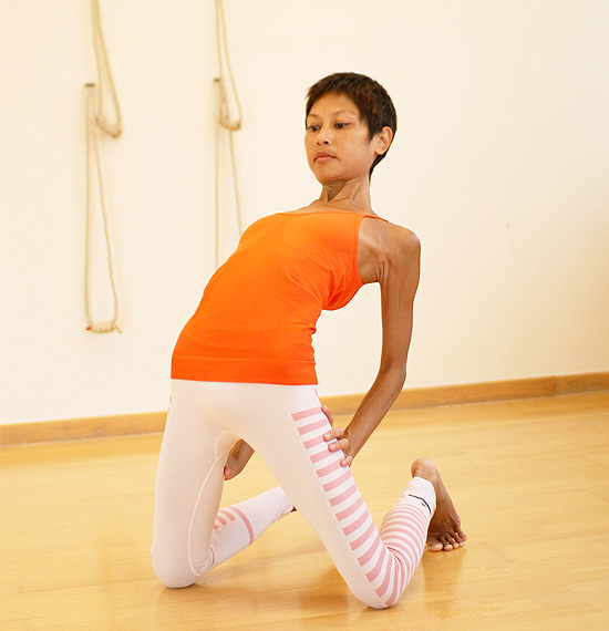 Pose #7: Ustrasana- strengthens foot, psoas and releases back.